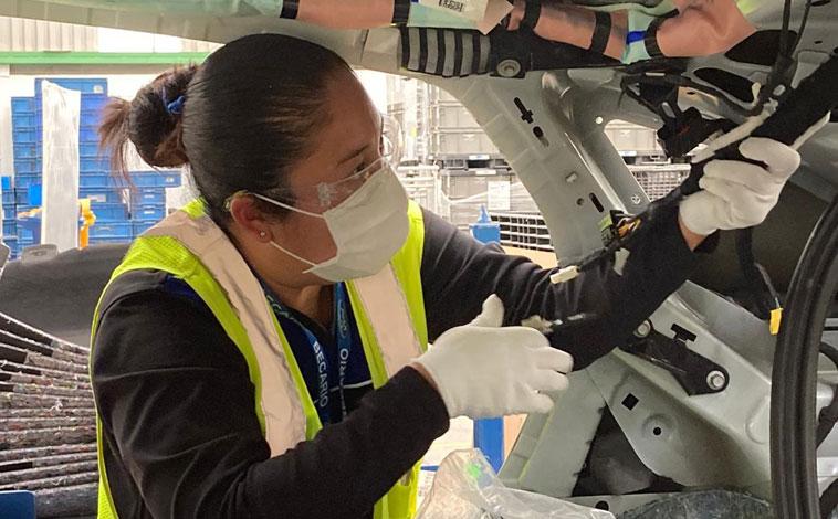 Women building Ford Mach-E
